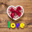 Word Love with heart shaped Valentines Day gift box — Stock Photo #45815893