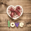 Word Love with heart shaped Valentines Day gift box — Stock Photo #45816201