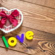 Word Love with heart shaped Valentines Day gift box — Stock Photo #45817283