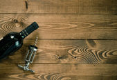 Red wine bottle with cork screw — Stockfoto