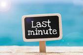 Last Minute by hand on a blackboard — Stock Photo