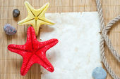 Starfishes and paper sheet — Stock Photo