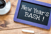 New Year's Bash handwritten on blackboard — Stock fotografie