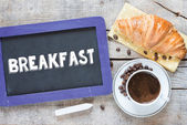 Breakfast written on blackboard — Stock Photo
