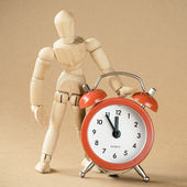 A mannequin and clock — Stock Photo