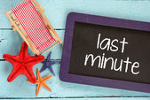Last minute sign on blackboard — Stockfoto
