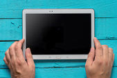 Hands hold tablet PC — Stock Photo