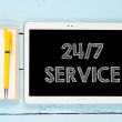 Tablet PC with words 24-7 service — Stock Photo #49770843