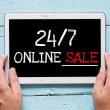 Tablet PC with words 24-7 online sale — Stock Photo #49771723