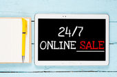 Tablet PC with words 24-7 online sale — Stock Photo