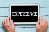 "Man hold tablet pc with text ""experience"" — Stock Photo"