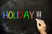 Holiday - chalk handwriting — Stock Photo