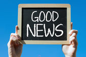 Chalkboard with text good news — Photo