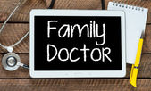 Tablet pc with word Family doctor and stethoscope — Stock Photo
