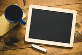 Small wooden framed blackboard with cup of coffee — Stock Photo