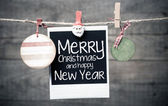 Old pictures on wood background with Christmas decoration — Stock Photo