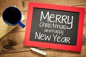 Merry Christmas handwritten with white chalk — Stock Photo