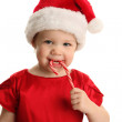 Baby in Santa hat with Candy Cane — Stock Photo #14880419