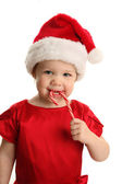 Baby in Santa hat with Candy Cane — Stock Photo