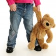 Toddler Holding Hands with a Teddy Bear — Stock Photo #23842595
