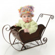 Baby sitting in a sled — Stock Photo #4521154