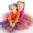 Sisters in bright tutu skirts — Stock Photo #4620120