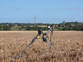 Metal detector in campo di stoppie — Foto Stock