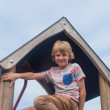 Young boy on climbing frame — Stock Photo