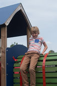 Young boy on climbing frame — Stock Photo