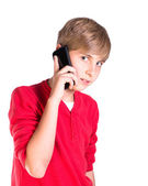 Young boy using mobile cell phone — Stock Photo