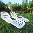 Two empty plastic chairs in park. Recreation on nature — Stock Photo
