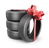 Tyres with a red ribbon. Present. 3D Icon isolated on white back — Stock Photo