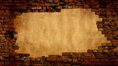 Plaster background with brick wall framing — Stock Photo
