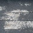 Rock texture on wooden slat - Photo