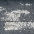Rock texture on wooden slat - Stock Photo