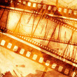 Vintage grunge texture with films strip — Stock Photo