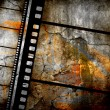 Retro grunge background with film strips — Stok fotoğraf