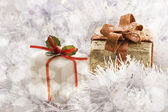 Christmas gift in Freezing Cold Winter Background — Stock Photo
