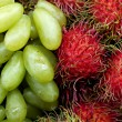 Delicious Rambutan and green grape — Stock Photo