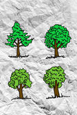 Set of trees with leaves on crumpled paper — Stock Photo