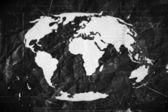 Globus erde symbole themes idee design auf zerknittertes papier — Stockfoto