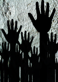 Colorful silhouette hands on Cement wall texture background desi — Stockfoto