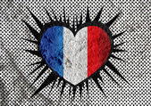 Love France flag sign heart symbol on Cement wall texture backgr — Stock Photo