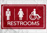 厕所图标和象形图男人女人标志在水泥墙上纹理 — 图库照片