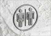 Restroom icon and Pictogram Man Woman Sign on Cement wall textur — Stock Photo