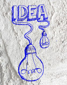 Idea Light bulb icon on Cement wall texture background design — Stock Photo