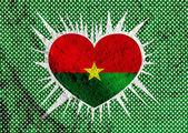 Burkina Faso flag themes idea design on wall texture background  — Stock Photo