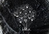 Idea Light bulb icon on wall texture background design — Stock Photo