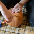 Person carves a pumpkin for Halloween — Stock Video #14178881