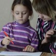 Mother and daughter paint pens on white paper — Stock Video